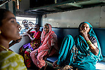 19 September  2013, New Delhi, INDIA:  Sondi (no last name given, at right) sitting with her friends from Maharashtra state in a women only carriage on a train from New Delhi's Nizamuddin Station destined for Gondwana in Vidarbha region of Maharashtra, with men peering through the windows. The recent spate of violent attacks against women in New Delhi has prompted segregation of the sexes on transport to be highlighted as a necessity. Many local women feel much safer travelling in taxi's driven by women and travelling in women only carriages on the railways. Picture by Graham Crouch for The Washington Post