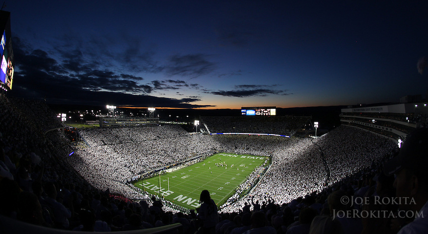 "State College, PA - 10/12/2013:  The sun set over the ""Whiteout"" at Beaver Stadium.  Penn State defeated Michigan by a score of 43-40 in four overtimes on Saturday, October 12, 2013, at Beaver Stadium.<br /> <br /> Photos by Joe Rokita / JoeRokita.com"