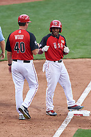 Team USA Tony Kemp (7) fist bumps coach Jason Wood (40) during the MLB All-Star Futures Game on July 12, 2015 at Great American Ball Park in Cincinnati, Ohio.  (Mike Janes/Four Seam Images)