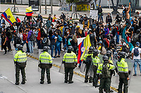 BOGOTA, COLOMBIA - APRIL 28 : National police officers stand guard as people protest during a national strike Against the Duque package and the tax reform on April 28, 2021 in Bogota, Colombia. Colombia has the minimum wage around $ 250 per month where people are unhappy about corruption, unemployment, and inequality by Government. (Photo by Leonardo Munoz/VIEWpress)