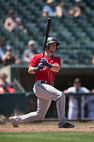 Tacoma Rainiers catcher Chris Herrmann (14) follows through on his swing during a Pacific Coast League game against the Sacramento RiverCats at Raley Field on May 15, 2018 in Sacramento, California. Tacoma defeated Sacramento 8-5. (Zachary Lucy/Four Seam Images)