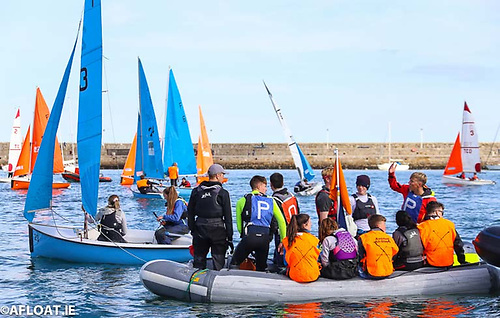 Youth sailors enjoy a team racing event competed for inside Dun Laoghaire Harbour