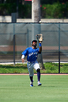 Toronto Blue Jays outfielder Justin Ammons (29) catches a fly ball during an Extended Spring Training game against the Philadelphia Phillies on June 12, 2021 at the Carpenter Complex in Clearwater, Florida. (Mike Janes/Four Seam Images)