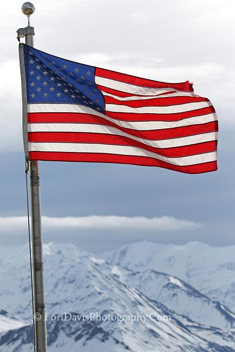 American Flag flying over Denali Range