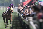 Jockey Karis Teetan riding Sum Win Dragoon celebrates after the winning of the Jardine's Lookout Handicap on 29 March 2017, at Happy Valley Racecourse  in Hong Kong, China. Photo by Chris Wong / Power Sport Images