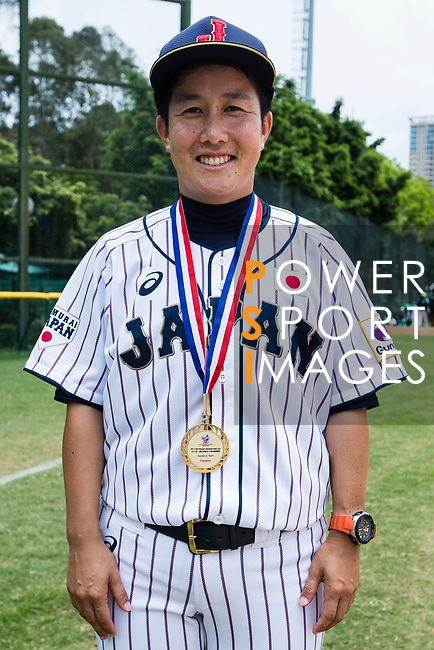Head coach Kitta Megumi #57 poses for photo with medal during the BFA Women's Baseball Asian Cup Presentation Ceremony at Sai Tso Wan Recreation Ground on September 7, 2017 in Hong Kong, China. Photo by Yu Chun Christopher Wong / Power Sport Images