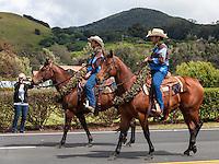 Riders participate in the Waimea Paniolo Parade on the Big Island.