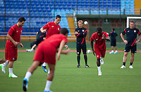 United States Men's National Team head coach Jurgen Klinsmann watches his team warm up during practice at Estadio Mateo Flores in Guatemala City, Guatemala on Mon. June 11, 2012.  The USA will face Guatemala in a World Cup Qualifier on Tuesday.