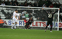 Pictured: Jamal Campbell-Ryce of Barnsley (2nd R) starts celebrating his penalty against Dorus de Vries (3rd R) of Swansea<br /> Re: Coca Cola Championship, Swansea City FC v Barnsley at the Liberty Stadium. Swansea, south Wales, Tuesday 09 December 2008.<br /> Picture by D Legakis Photography / Athena Picture Agency, Swansea 07815441513