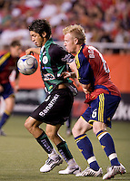 Real Salt Lake defender Chris Wingert (l) and Santos Laguna Forward Oribe Peralta (r) in the 2009 Xango Cup Friendly between Real Salt Lake and Santos Laguna. Santos win 4-1 over Real Salt Lake on July 9, 2008 at Rice-Eccles Stadium in Salt Lake City, Utah.