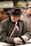 Chelteham Horse racing Festival Gloucestershire Man wearing brown tweed coat and brown trilby hat.