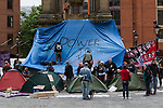© Joel Goodman - 07973 332324  . 04/10/2011 . Manchester, UK . Anti government protesters in Albert Square in Manchester City Centre during the 2011 Conservative Party Conference at the Manchester Central Convention Centre (formerly GMex) . Photo credit: Joel Goodman