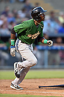 Savannah Sand Gnats center fielder Champ Stuart #7 runs to first during a game against the Asheville Tourists at McCormick Field September 3, 2014 in Asheville, North Carolina. The Tourists defeated the Sand Gnats 8-3. (Tony Farlow/Four Seam Images)