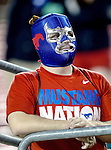 Southern Methodist Mustangs fans watch the action during the game between the University of Houston Cougars and the Southern Methodist Mustangs at the Gerald J. Ford Stadium in Dallas, Texas. SMU defeats Houston 72 to 42...