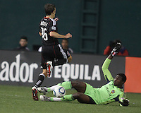 Josh Wolfe (16) of D.C. United loses the ball to Donovan Ricketts (1) of the Los Angeles Galaxy during an MLS match at RFK Stadium, on April 9 2011, in Washington D.C.The game ended in a 1-1 tie.