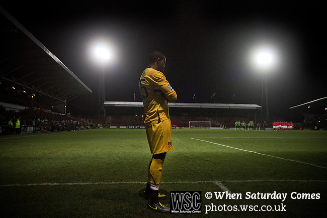 Wrexham 1 Brighton & Hove Albion 1, 18/01/2012. Racecourse Ground, FA Cup 3rd Round Replay. Wrexham goalkeeper Joslain Mayebi waiting pensively for the start of the penalty shoot out against Brighton and Hove Albion in an FA Cup third round replay, at the Racecourse Ground played following the teams one-all draw in the first match. The replay was won by Brighton, 5-4 on penalty kicks after the match had ended in a one-all draw after extra time, watch by a crowd of 8316. The visitors played in the Championship, three leagues above their rivals from Wales, who were top of the Conference at the time of the match. Photo by Colin McPherson.