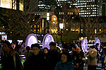 Tokyo, Japan - Pedestrians at the opening ceremony of the Tokyo Michiterasu 2013, in front of Tokyo Station on December 24, 2013. The illumination of this year presents the light wheels on light railway and the light train windows. The event starts from December 24th to 29th at around Tokyo Station. (Photo by Rodrigo Reyes Marin/AFLO)