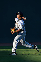 Starting pitcher Rony Garcia (19) of the Charleston RiverDogs warms up before Game 2 of the South Atlantic League Southern Division Playoff against the Greenville Drive on Friday, September 8, 2017, at Fluor Field at the West End in Greenville, South Carolina. Charleston won, 2-1, and the series is tied at one game each. (Tom Priddy/Four Seam Images)