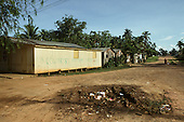 """Xapuri, Acre State, Brazil. Poor house with """"The cowards killed our Chico"""" painted on the wall in a poor street."""