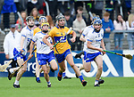Dylan Mc Mahon of Clare  in action against the Waterford attackers during their Munster  championship round robin game at Cusack Park Photograph by John Kelly.