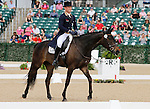 LEXINGTON, KY - APRIL 28: #34 Fischerrocana FST and rider Michael Jung from Germany, competing on day one of Dressage at the Rolex Three Day Event where they finished in 1st place.   Returning winners, this pair won the Rolex Three Day Event in 2015.  April 28, 2016 in Lexington, Kentucky. (Photo by Candice Chavez/Eclipse Sportswire/Getty Images)