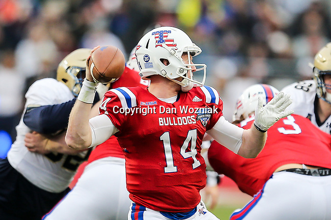 Louisiana Tech Bulldogs quarterback Ryan Higgins (14) in action during the Armed Forces Bowl game between the Louisiana Tech Bulldogs and the Navy Midshipmen at the Amon G. Carter Stadium in Fort Worth, Texas.