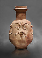 Ancient Egyptian god Bes jar, Late Period, 5th century BC.  Egyptian Museum, Turin. Drovetti collection cat 2553. Grey background;
