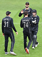 20th March 2021; Dunedin, New Zealand;  Tom Latham celebrates with Mitchell Santner the wicket of Mehidy Hasan Miraz during the New Zealand Black Caps v Bangladesh International one day cricket match. University Oval, Dunedin.