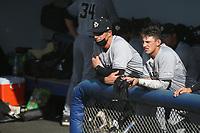 Cal State San Luis Obispo Mustangs Head Coach Larry Lee (25) talks with his son and Mustangs shortstop Brooks Lee (22) before a game against the UC Santa Barbara Gauchos at Caesar Uyesaka Stadium on April 30, 2021 in Santa Barbara, California. (Larry Goren/Four Seam Images)