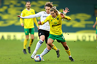 20th February 2021; Carrow Road, Norwich, Norfolk, England, English Football League Championship Football, Norwich versus Rotherham United; Kieran Sadlier of Rotherham United challenges Todd Cantwell of Norwich City