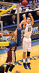 BROOKINGS, SD - FEBRUARY 27:  Chad White #25 from South Dakota State spots up for a three pointer over Brett Olson #23 from Denver University in the first half of their game Thursday night at Frost Arena in Brookings. (Photo by Dave Eggen/Inertia)