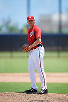 GCL Nationals relief pitcher Leif Strom (46) gets ready to deliver a pitch during a game against the GCL Mets on August 4, 2018 at FITTEAM Ballpark of the Palm Beaches in West Palm Beach, Florida.  GCL Nationals defeated GCL Mets 7-4.  (Mike Janes/Four Seam Images)