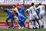 07.02.2021 Hamilton v Rangers: Allan McGregor saves in a sea of bodies