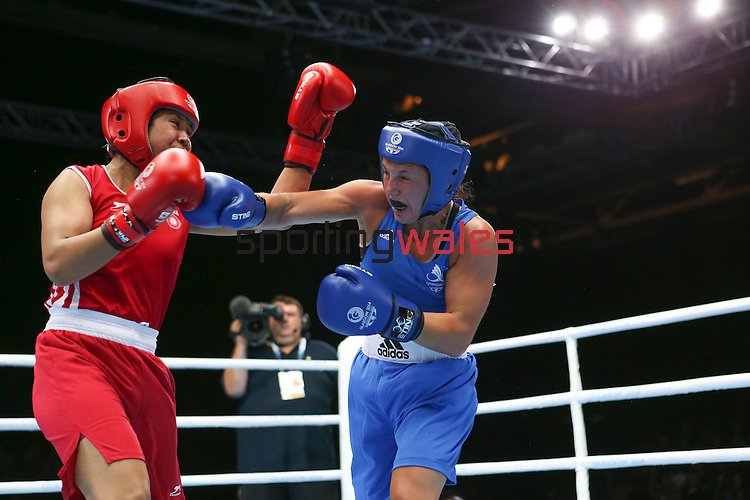Glasgow 2014 Commonwealth Games<br /> <br /> Charlene Jones, Wales (Blue) v Laishram Devi, India (red)<br /> <br /> 30.07.14<br /> ©Steve Pope-SPORTINGWALES