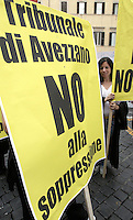 Operatori della giustizia durante una protesta contro la chiusura dei piccoli tribunali prevista dalla spending review del governo, a Roma, 24 luglio 2012..Law courts employees attend a protest against government's closure of small courts, in Rome, 24 july 2012. .UPDATE IMAGES PRESS/Riccardo De Luca