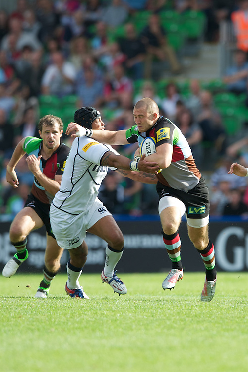 Mike Brown of Harlequins forces his way past Sam Tuitupou of Sale Sharks during the Aviva Premiership match between Harlequins and Sale Sharks at The Twickenham Stoop on Saturday 15th September 2012 (Photo by Rob Munro)