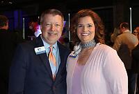Steven and Christina Hinds stand for a photo at the merger celebration. <br /> (NWA Democrat-Gazette/Carin Schoppmeyer)