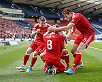 Ryan Christie congratulated on his goal by Johnny Hayes and Ash Taylor