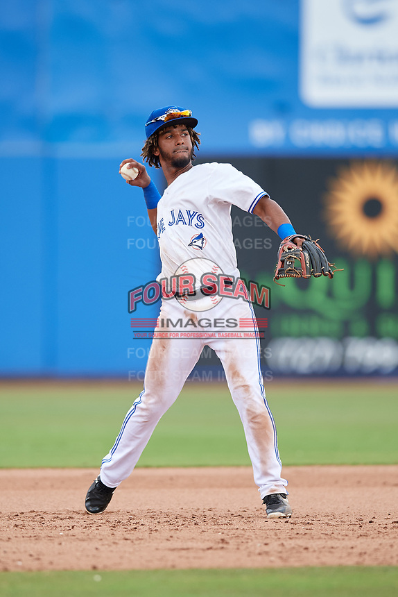 Dunedin Blue Jays third baseman Ivan Castillo (1) throws to first base during a game against the Clearwater Threshers on April 8, 2018 at Dunedin Stadium in Dunedin, Florida.  Dunedin defeated Clearwater 4-3.  (Mike Janes/Four Seam Images)