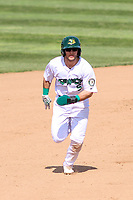 Beloit Snappers shortstop Ryan Gridley (5) runs to third base during a Midwest League game against the Cedar Rapids Kernels on June 2, 2019 at Pohlman Field in Beloit, Wisconsin. Beloit defeated Cedar Rapids 6-1. (Brad Krause/Four Seam Images)