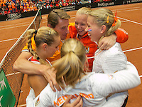 The Netherlands, Den Bosch, 20.04.2014. Fed Cup Netherlands-Japan, Arantxa Rus (NED) wins the deciding point, and celebrates the victory with the Dutch team, Holland goes to the world group<br /> Photo:Tennisimages/Henk Koster