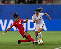 GRENOBLE, FRANCE - JUNE 15: Jayde Riviere #8 of the Canadian National Team tackles Ali Riley #7 of the New Zealand National Team during a game between New Zealand and Canada at Stade des Alpes on June 15, 2019 in Grenoble, France.
