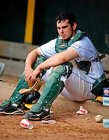 30 April 2009: University of Vermont Catamounts' catcher Mike McCarthy, a Freshman from Wallingford, CT, sits outside the dugout during a game against the Siena College Saints at Historic Centennial Field in Burlington, Vermont. The Saints outscored the Catamounts 11-10 in the afternoon matchup. The Catamounts are playing their last season of baseball, as the program has been marked for elimination due to budgetary constraints at the University. Mandatory Photo Credit: Ed Wolfstein Photo