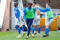 1st May 2021; Weston Homes Stadium, Peterborough, Cambridgeshire, England; English Football League One Football, Peterborough United versus Lincoln City; Peterborough United players celebrate their equalising goal after 95 minutes, guaranteeing promotion to the EFL Championship