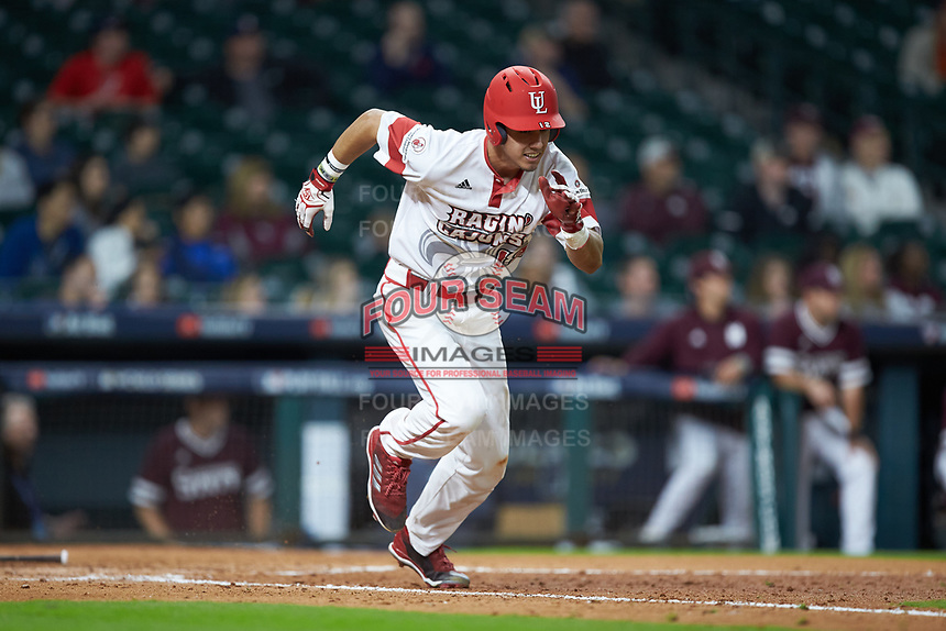 Jonathan Windham (12) of the Louisiana Ragin' Cajuns hustles down the first base line against the Mississippi State Bulldogs in game three of the 2018 Shriners Hospitals for Children College Classic at Minute Maid Park on March 2, 2018 in Houston, Texas.  The Bulldogs defeated the Ragin' Cajuns 3-1.   (Brian Westerholt/Four Seam Images)