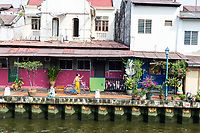 Old Shophouses Line the Riverwalk along the Melaka River, Melaka, Malaysia.