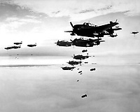USS ESSEX based TBMs and SB2Cs dropping bombs on Hokadate, Japan.  July 1945.  (Navy)<br /> Exact Date Shot Unknown<br /> NARA FILE #:  080-G-490232<br /> WAR & CONFLICT BOOK #:  1238