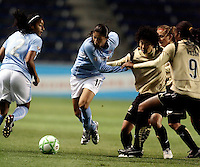 Chicago Red Star forward Cristiane (11) attempts to break away from FC Gold Pride forwards Eriko Arakawa (30) and Kandace Wilson (9).  The defeated the FC Gold Pride defeated the Chicago Red Stars 1-0 at Toyota Park in Bridgeview, IL on May 16, 2009.