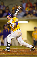 Tyler Hanover #11 of the LSU Tigers follows through on his swing against the Wake Forest Demon Deacons at Alex Box Stadium on February 18, 2011 in Baton Rouge, Louisiana.  The Tigers defeated the Demon Deacons 15-4.  Photo by Brian Westerholt / Four Seam Images