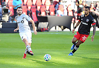 WASHINGTON, DC - NOVEMBER 8: Rudy Camacho #4 of Montreal Impact battles for the ball with Gelmin Rivas #20 of D.C. United during a game between Montreal Impact and D.C. United at Audi Field on November 8, 2020 in Washington, DC.